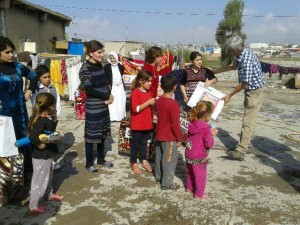 Distributing electric heaters in Iraq to refugees